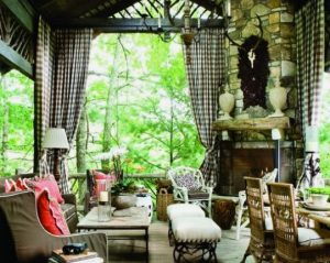 outdoor curtains on a covered patio with fireplace