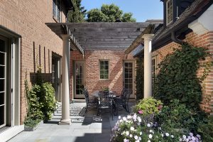 Pergola positioned in courtyard