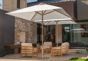 Shade umbrellas for lounge chairs on patio
