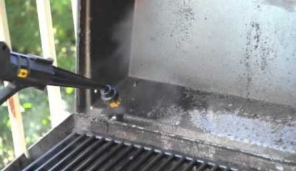 cleaning a grill with steam and brush attachment
