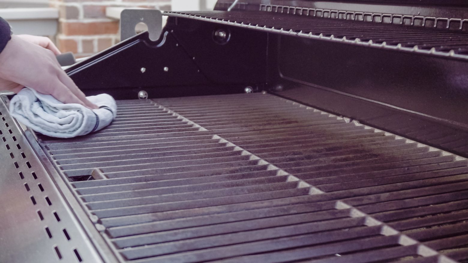 cleaning the grill with a soft cloth