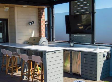 outdoor kitchen with wood cabinetry
