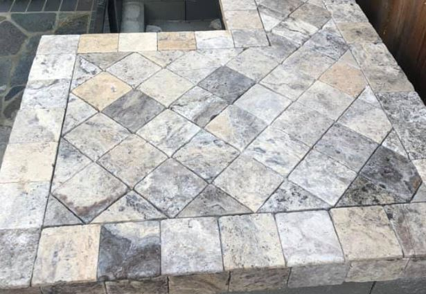 outdoor kitchen tile countertop laid on a diagonal with bullnose