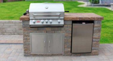 outdoor fridge installed inside a grill island