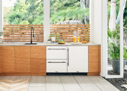Outdoor kitchen with 2 drawer outdoor refrigerator and single door freezer